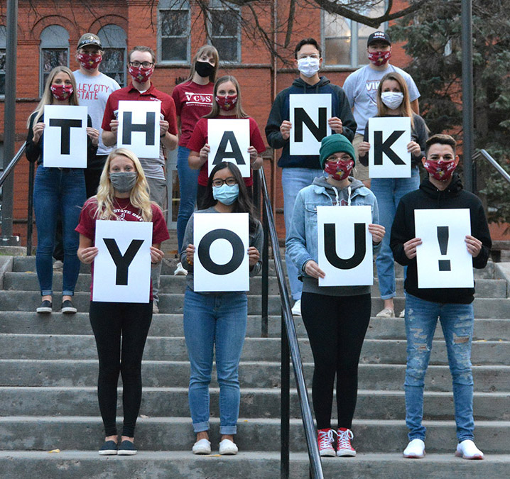 """VCSU students hold signs spelling out """"Thank You"""""""