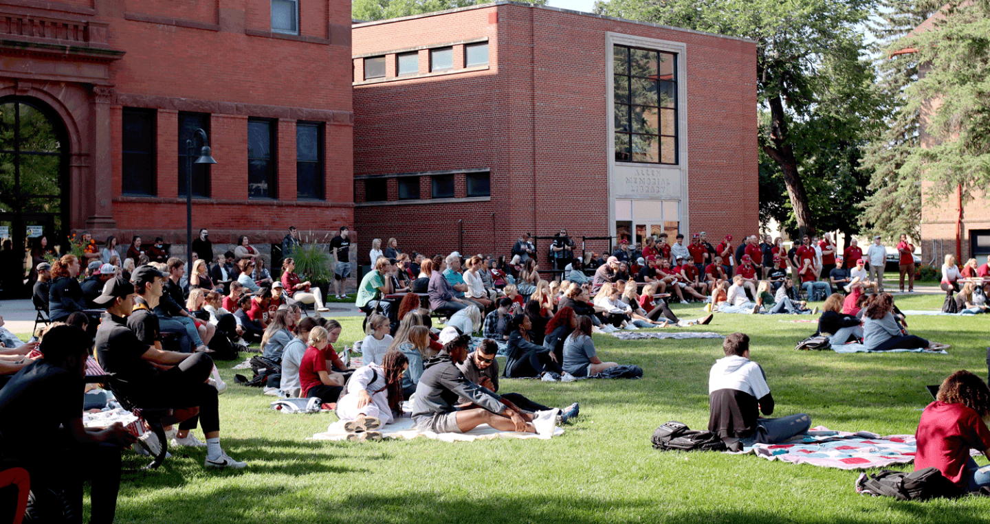 Students on the lawn at Valley City State University