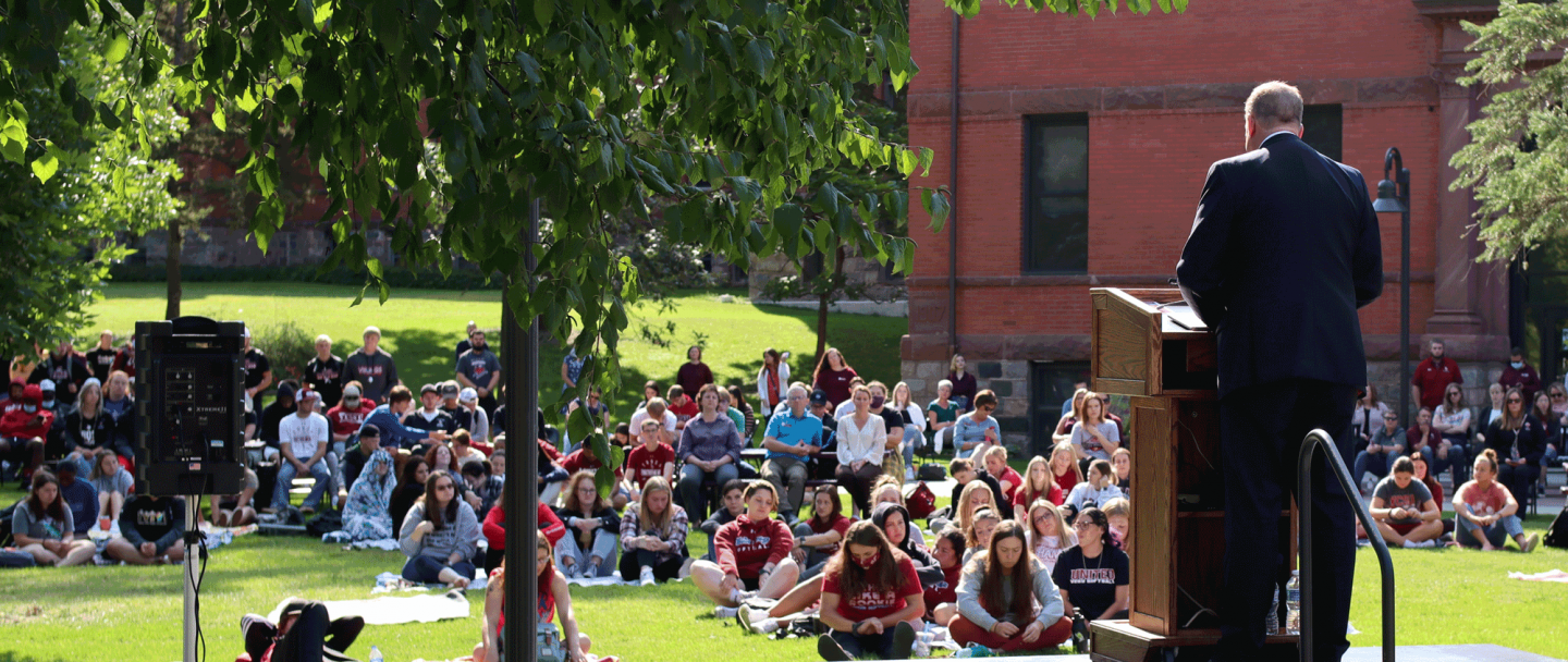 A photo of President Alan LaFave speaking at convocation