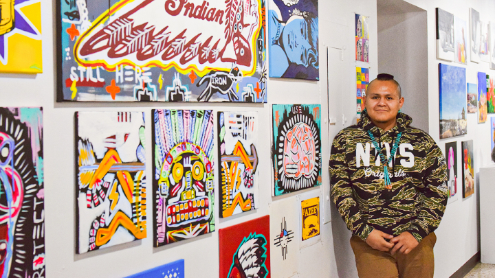 VCSU student displaying artwork at exhibition