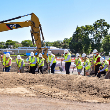 Individuals in hard hats with shovels participating in the groundbreaking ceremony for the new VCSU Center for the Arts