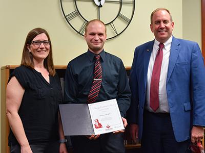 Kenton Sandfoss receiving award