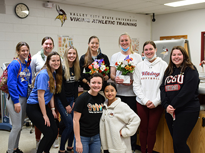 Athletic training staff with students