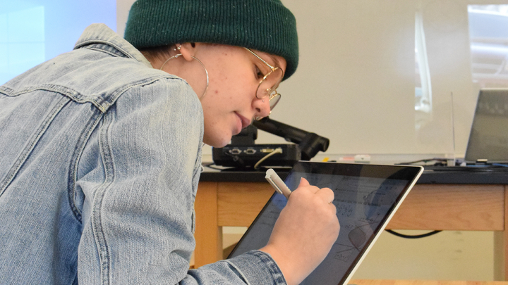 math student working on device