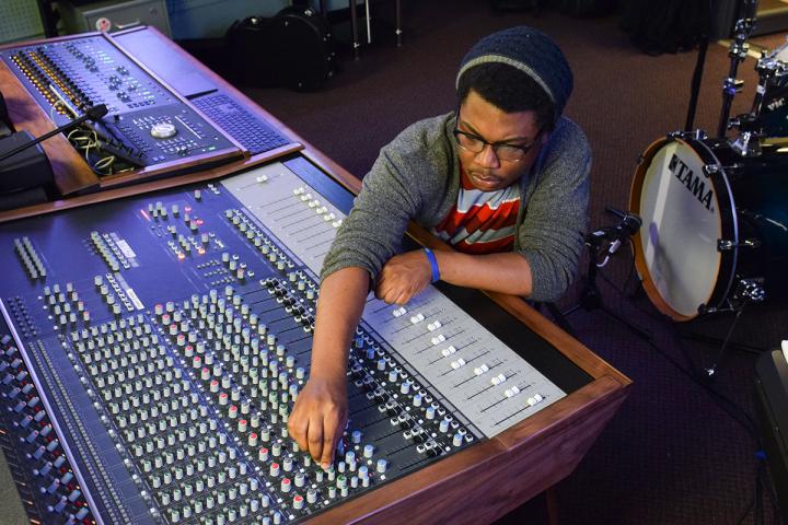Student using the recording equipment